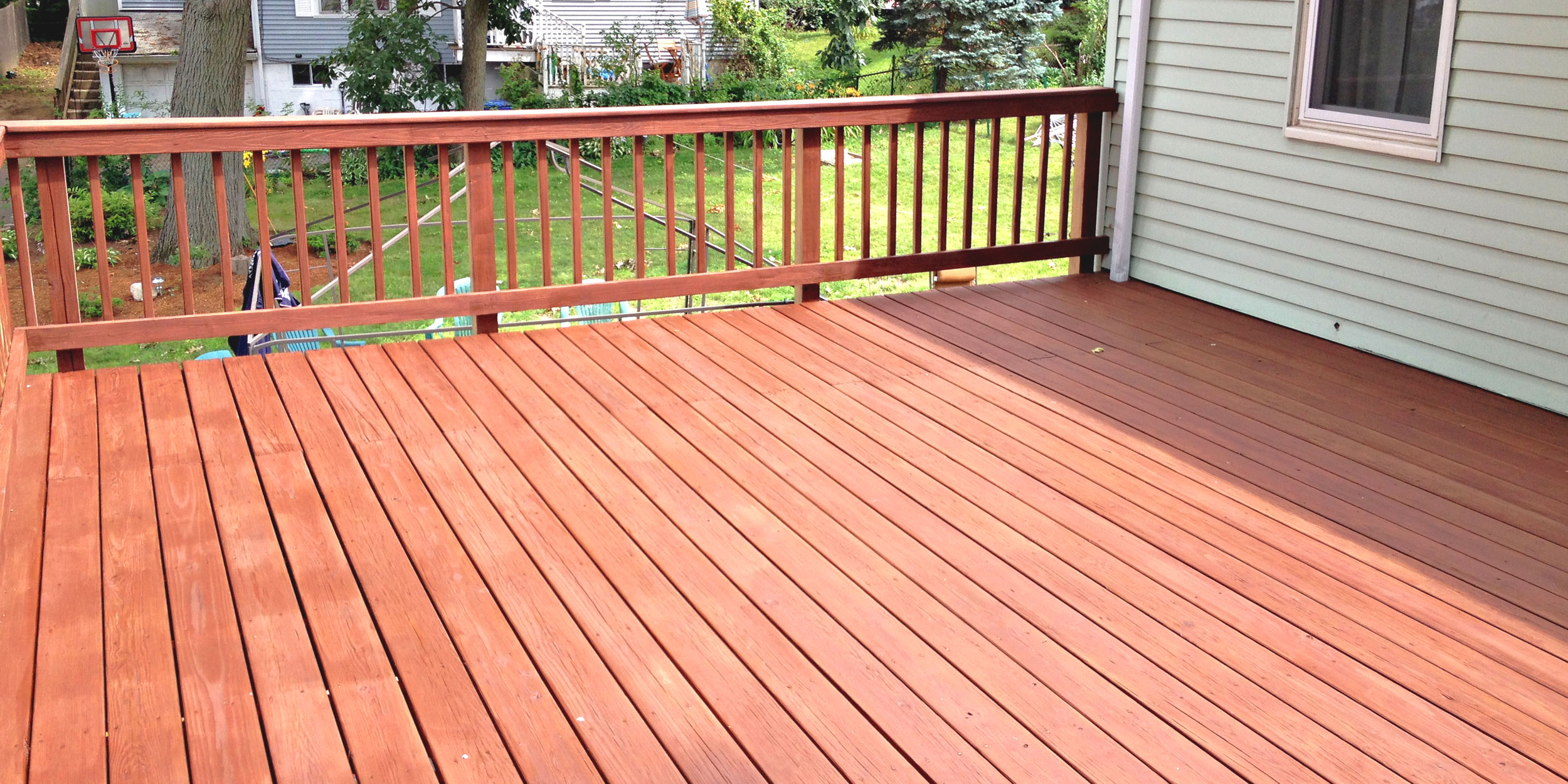 Exterior deck staining done by Mystic Painting Co. in Wakefield, MA