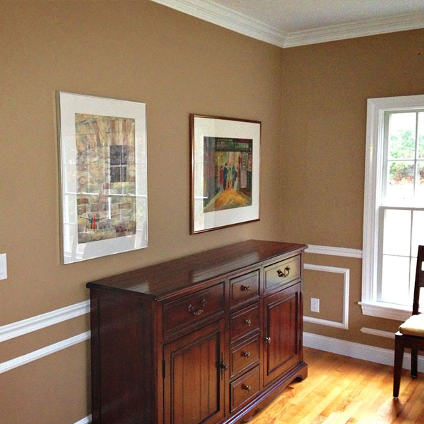 Two paintings and a chair kept in a room in Wakefield, MA