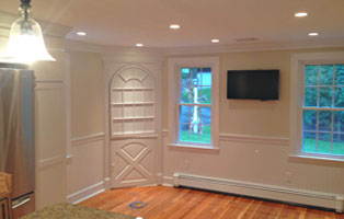 Entrance of a house with freshly painted white walls in Wakefield, MA